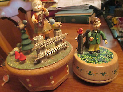 Two vintage Anri Italian wood music boxes rotating to danny boy and Edelweiss