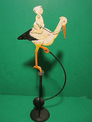 Baby Riding / Arriving On A Stork Balance Toy Skyhook Teeter Totter