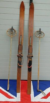 SMALL  ANTIQUE VINTAGE WOODEN SKIS AND POLES WITH CABLE BINDINGS 149cm