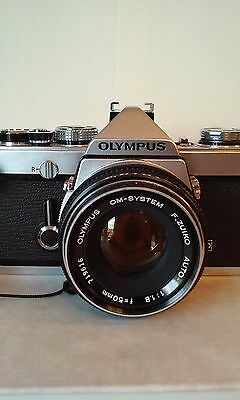 Olympus OM-1 SLR Film Camera with two lens, case, and fanny pack