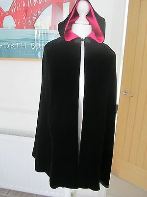 Laura Ashley girl's cloak in black velvet with pink lining. Age 4 +