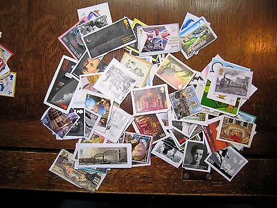 100 1st Class larger style commemorative Stamps UN-FRANKED ON PAPER.NO GUM