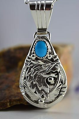 Navajo crafted sterling silver Kingman Turquoise pendant w/ eagle head