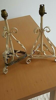 Matching pair of antique wrought iron lamps