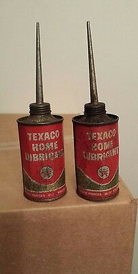 Vintage pair of empty texeco home lubricant cans