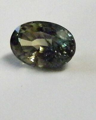Natural Australian earthmined  green yellow oval sapphire ..0.65  carat