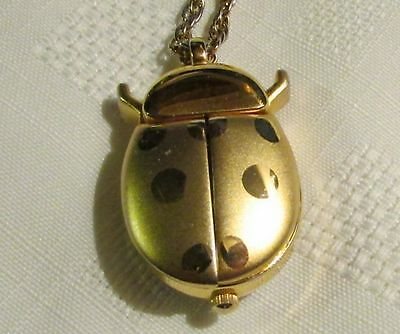 COLLEZIO  Gold Toned Lady Bug  Pendant Watch  Keeps good time.