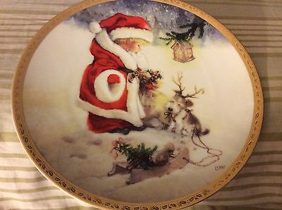 Lisi Martin Xmas Plate--Santa's Littlest Reindeer. Is numbered with Cert. of Aut