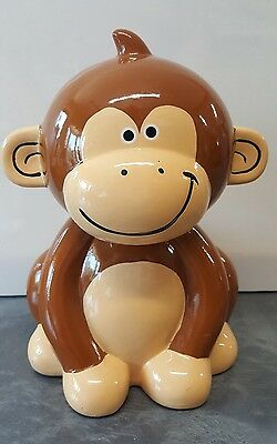 Monkey Figural Ceramic Piggy Bank with Glossy Finish and Plastic Coin Stopper
