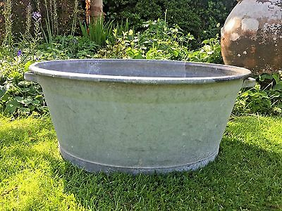 Big chunky vintage galvanised tin bath garden planter feature