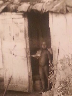 Vintage photo of  African American little child in an outhouse or bath house