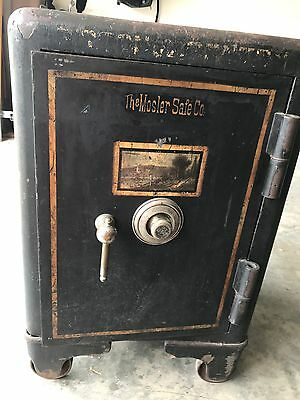 Antique Mosler Company Safe on Wheels with shelves on the inside.