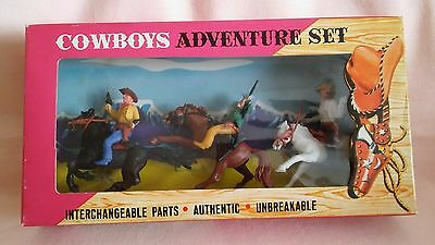 VINTAGE  BOXED SET OF 3 PLASTIC COWBOYS  ON HORSE,S FROM THE 1970,s,NICE SET.