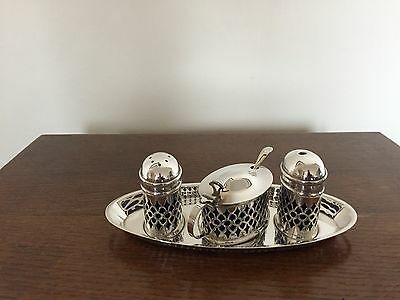 3 Piece Silver Plated Pierced Cruet Set On A Stand Along With Mustard Spoon