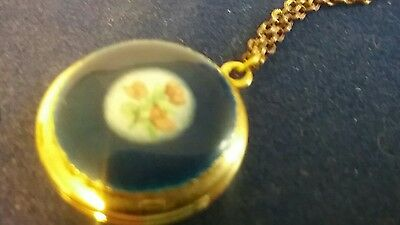 Vintage beautiful blue and gold locket with a hand-painted design on the front.