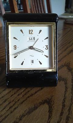 Small Vtg Bucherer  Traveling Alarm Clock 8 day date and day swiss working well.