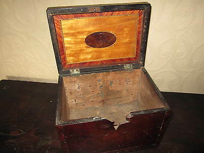 An inlaid Georgian tea caddy