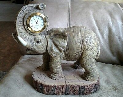 RESIN Elephant clock 7 1/2 inches tall...quartz clock with Roman numerals