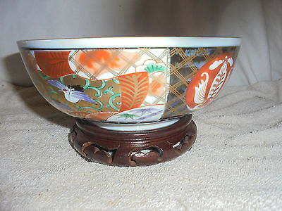Vintage Japanese imari bowl with rosewood stand