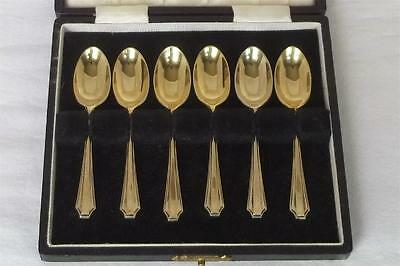 A CASE SET OF SIX SOLID SILVER GILDED COFFEE SPOONS LONDON 1939 BY HARRODS Ltd.