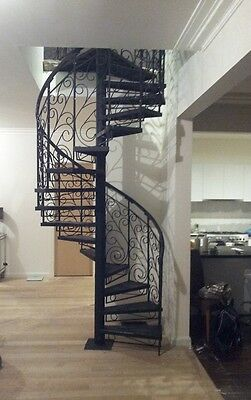 Wrought iron ornate bal'trade 1500 dim,$1750/M height spiral staircase