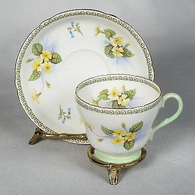 Shelley Teacup & Saucer - White/mint Green Decorated With Yellow Primrose