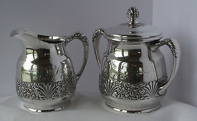Pitcher & Canister - Pairpoint Silver Co.  #2036 - Embossed Floral Motif -