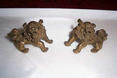 Pair of delightful tiny lion/ temple dogs, cast brass or bronzed