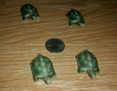 Four (4) adorable ceramic turtles