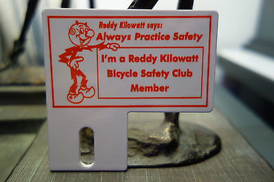 Reddy Kilowatt BICYCLE SAFETY LICENSE PLATE TOPPER ELECTRIC CO GIFT PRISTINE!