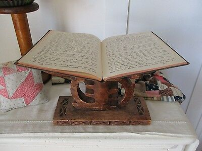 Wood book stand with nice design.