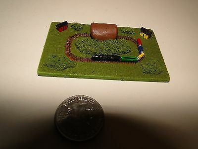 "Dollhouse Miniatures Train Set on a Wood Table, Green Spring, 3"" X 2"" • $12.95"