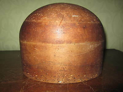 An old milliners wooden hat block