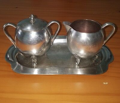 Silver plated creamer and sugar bowl with lid on a tray Keystoneware