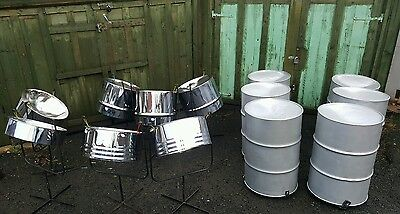 Full set of chrome steel pan drums ( silver bass ). Stands and sticks included.
