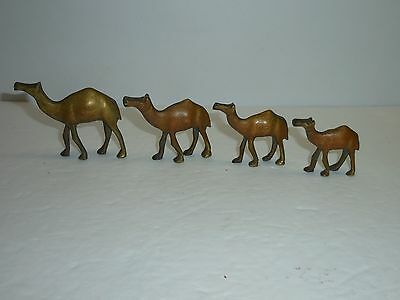 "Four Miniature Metal One Hump Camel Figurines 1.5"" to 2"" Tall"