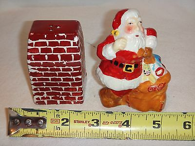 2005 Coca Cola Salt and Pepper Shakers Santa at Fireplace
