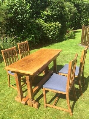 Arts and Crafts oak Ee-zi-way extending dining table and four chairs 1920s