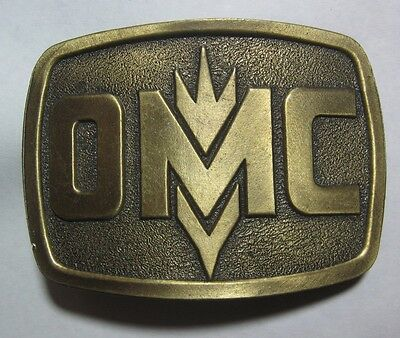 OMC Owatonna Manufacturing Co. advertising belt buckle Lewis Buckles of Chicago