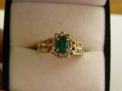9ct Yellow gold ring with diamonds and created emerald