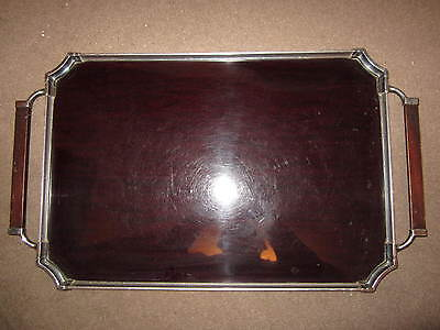 An old chrome and bakelite tray