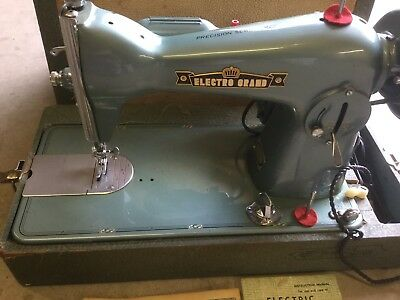 Vintage Electro Grand Sewing Machine With Case And Manual