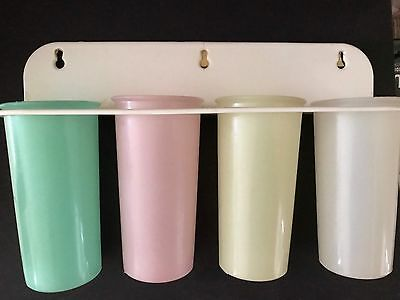 Vintage Tupperware Spice Canisters with wall rack
