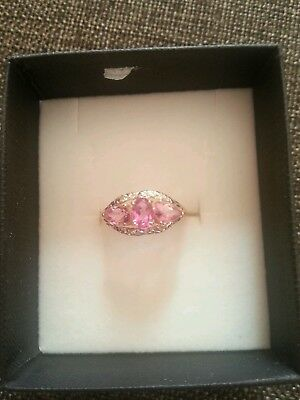 9ct gold ring with pink topaz and diamonds