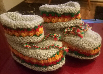 Hand knitted baby clothes, baby slippers.