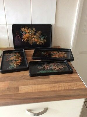 Set Of 4 Chinese Black Lacquered Trays Depicting Dragons