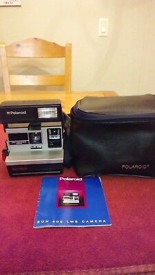 Vintage Polaroiid Sun 600 LMS  Instant Camera With Strap, Book & carrying Case