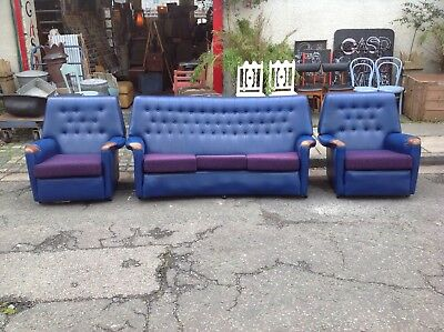Vintage 1960's blue vinyl 3 piece suite, sofa and 2 armchairs, popper back