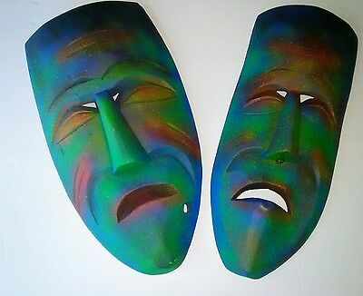 "2 carved wooden masks airbrushed 8"" tall"