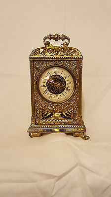 ornate chased brass carriage clock